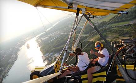 $  50 for a 30-Minute Powered Hang-Gliding Lesson at Amphibian Air in Garden City ($  100 Value)