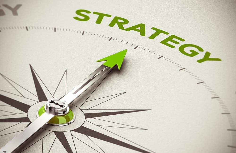 4 Steps to Create a Smarter, More Strategic Marketing Plan for Your Small Business: Compass face with arrow pointing to the word 'Strategy'