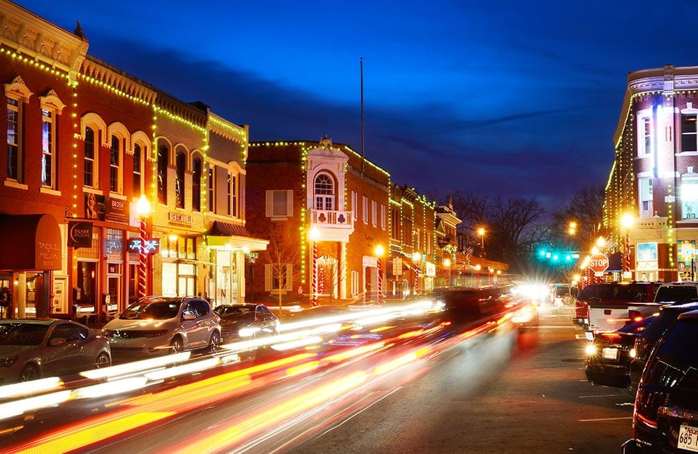 5 HyperLocal Marketing Tips for Your Small Business: Busy Main Street business district at dusk